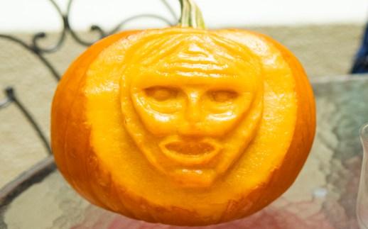 Pumpkin carved as man's face