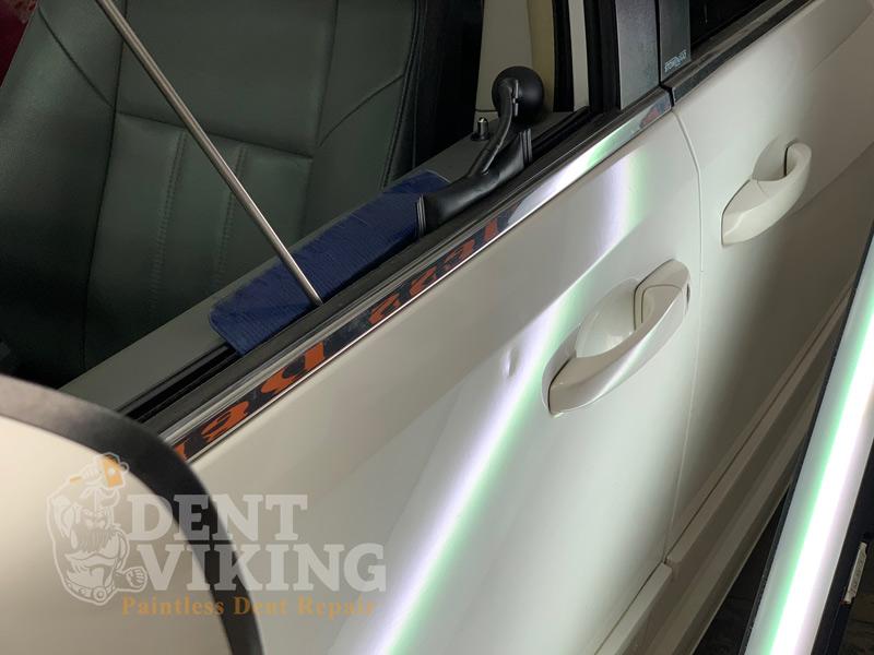 paintless dent repair on top of door