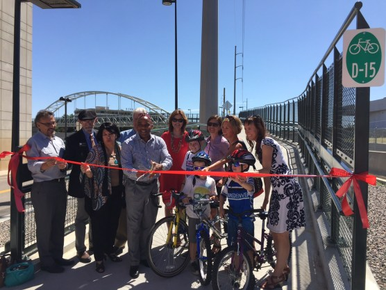 Mayor Michael Hancock cuts the ribbon to the new bridge. Photo: David Sachs