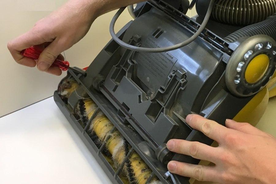 Denver Vacuum Store tech repairing a vacuum