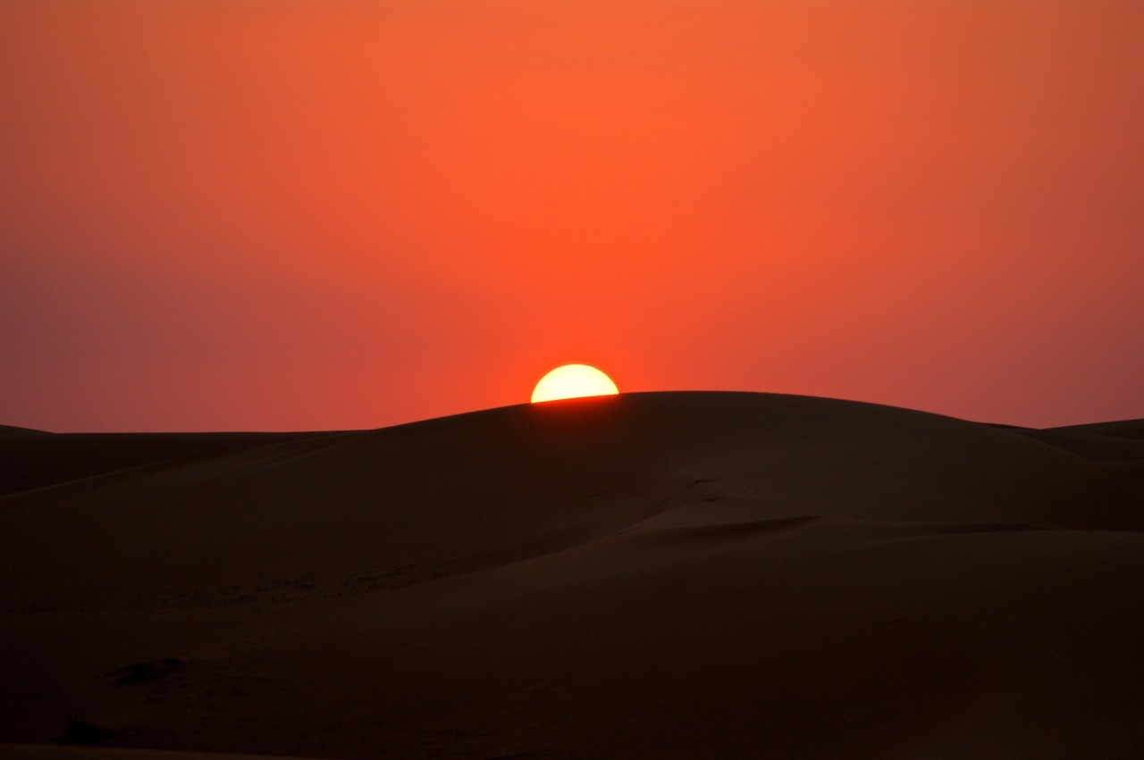 Catching the sunset at Dubai's sand dunes