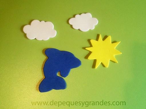 nubes, delfín y sol