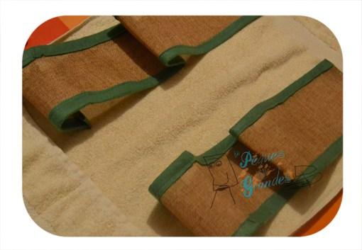 bandas de arpillera cosidas a la toalla