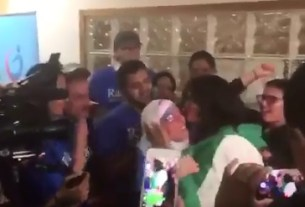 Rashida Tlaib covers herself with Palestinian flag at victory party