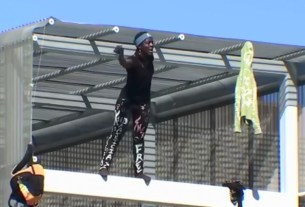 Woman who climbed the Statue of Liberty last 4th of July, climbs the Southwest Key building in Austin, Texas