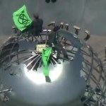 Climate change activists superglue themselves to globe at Universal Studios