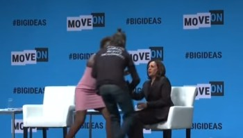 Protester grabs microphone from Kamala Harris