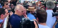 Joe Biden Forcefully Grabs Young Woman