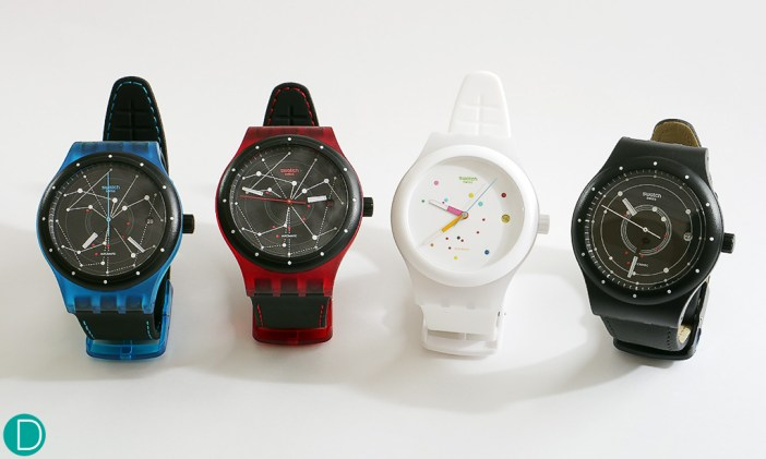 All in a row, the Swatch Sistem 51 in the 4 available colours: blue, red, white and black.