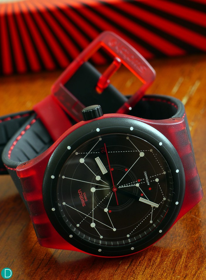 Swatch Sistem 51 in red.