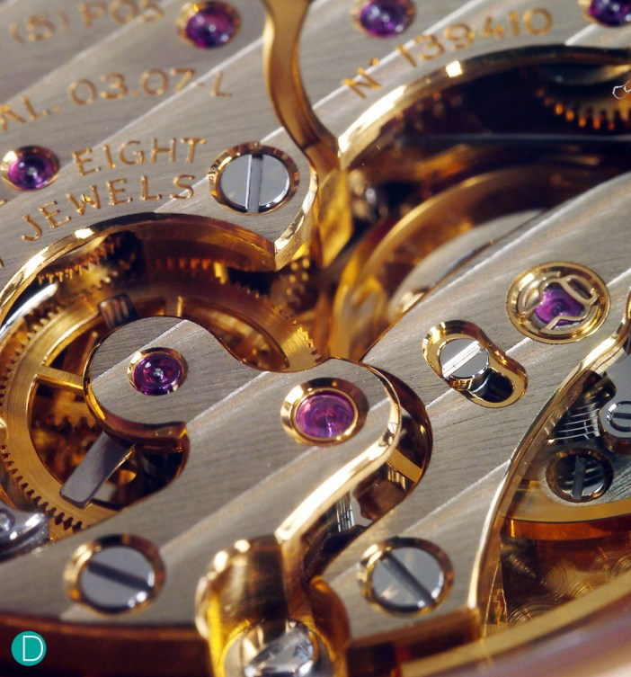 Detail of the movement, showing the German Silver bridges executed with complex shapes. Note the beautiful anglage which is highly polished and catches the light, gleaming.
