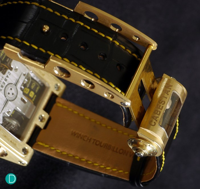 The buckle is also unique. And houses a little winch in a compartment. The winch is used to wind and set the watch.