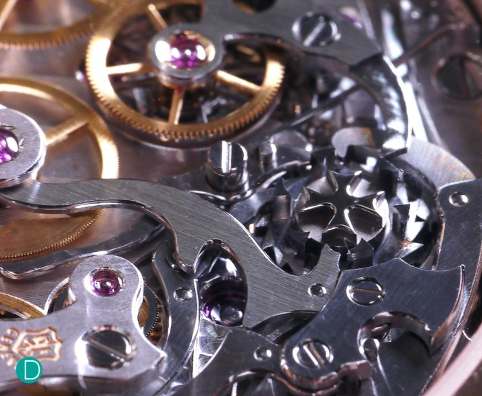 The chronograph works, showing the column wheel and the levers actuating the lateral clutch system of the chronograph.