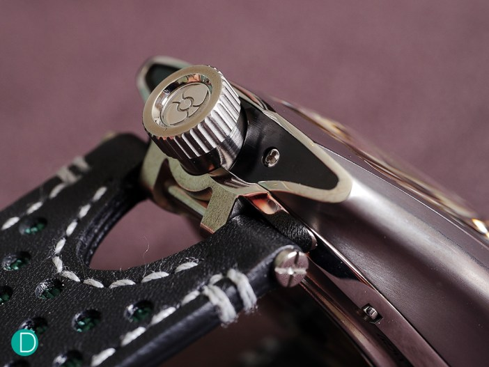 MB&F HMX detailing. The crown bears the emblemetic battle axe of MB&F. Case finish is beautiful, with a nice, smooth organic feel as one runs one's fingers on the case.