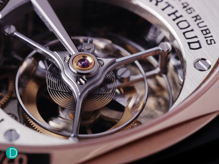 Detail on the tourbillon. Note the sharp points on the decorative stylized triangle on top of the three arms of the tourbillon cage. These points are executed par excellence. And the polishing very well done.