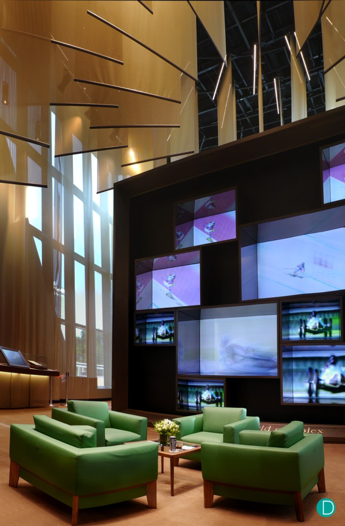 The video wall showing Rolex's various philanthropic and sponsorship projects involving artistic and sporting endeavours.