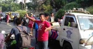 Seorang pengendara sepeda motor tewas seketika di Jalan Raya Muhtar Sawangan setelah digilas bus pariwisata.