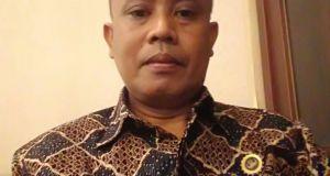 Tatang,  Kepala SMK Negeri 2 Depok.
