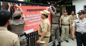 Bangunan dan tanah yang menunggak PBB akan dipasang stiker seperti di Jakarta.