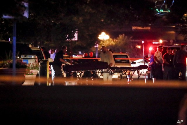 Bodies are removed from at the scene of a mass shooting, Sunday, Aug. 4, 2019, in Dayton, Ohio. Several people in Ohio have been killed in the second mass shooting in the U.S. in less than 24 hours, and the suspected shooter is also deceased, police…