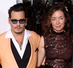 "BROOKLINE, MA - SEPTEMBER 15: (L-R) Actors Dakota Johnson, Johnny Depp, Julianne Nicholson and Jesse Plemons attend the Boston premiere of ""Black Mass"" at Coolidge Corner Theater on September 15, 2015 in Brookline, Massachusetts.  (Photo by Mike Lawrie/WireImage)"
