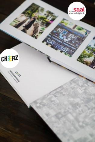 Fotobuch Cheerz Saal-Digital Vergleich Fotoalbum Logo 2