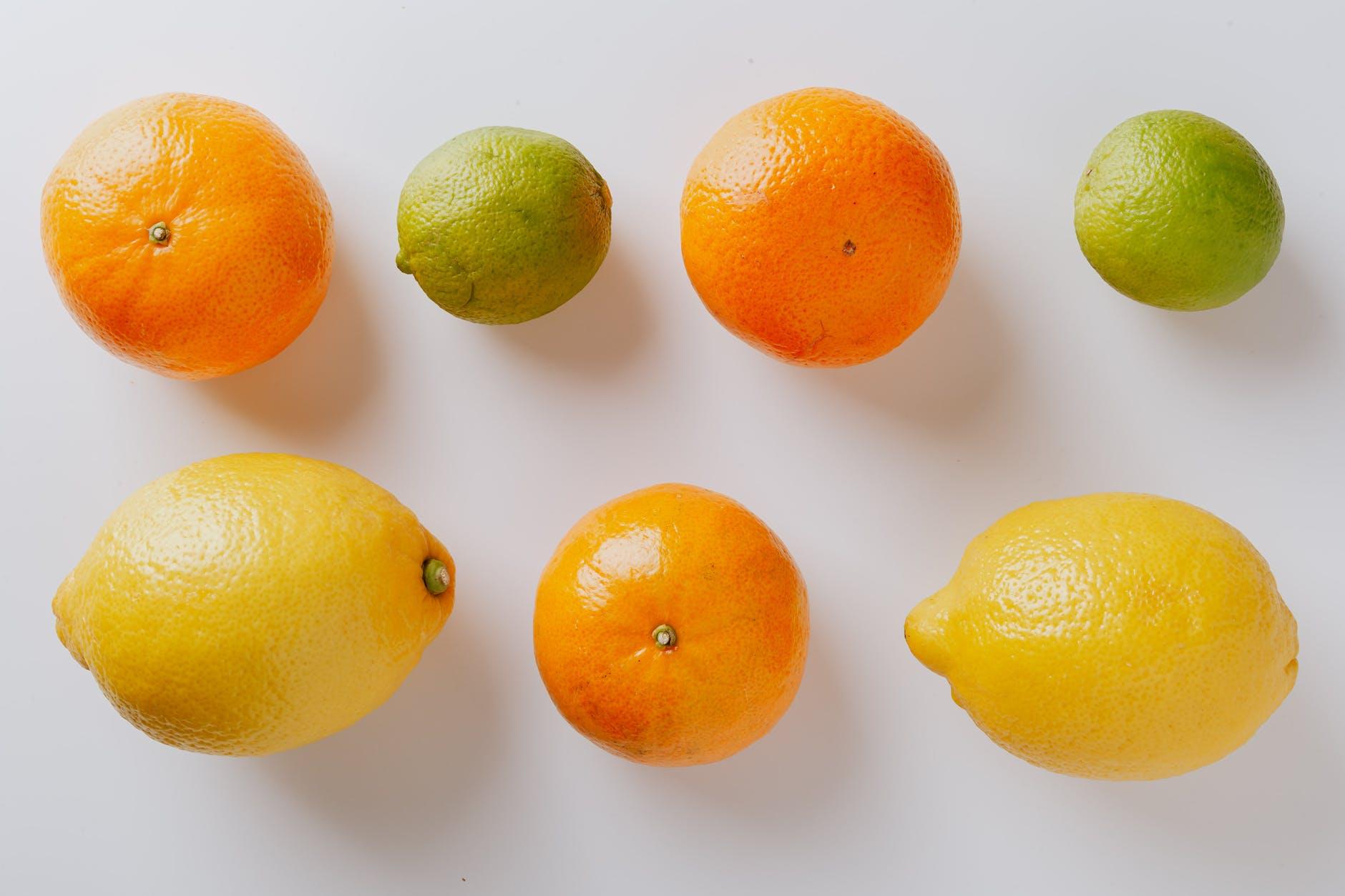 photo of orange near lemon