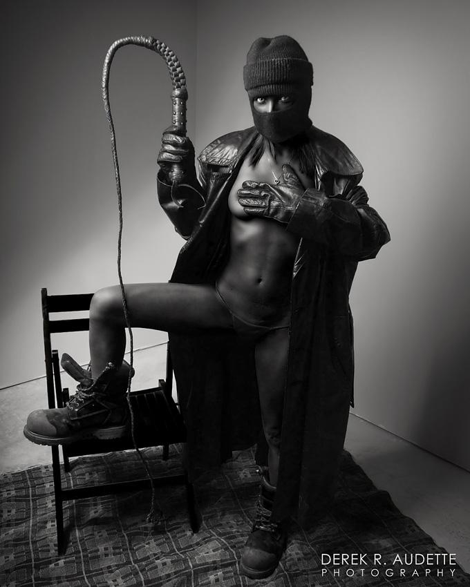"""Black Woman Holding Bullwhip"" - Photography by Derek R. Audette"