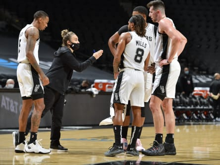 Rebecca Hammon coaches Spurs after coach Gregg Popovich was expelled.