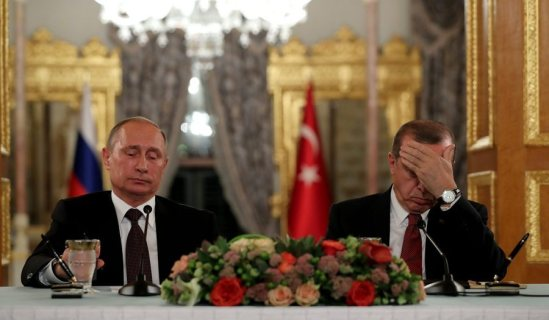 epa05580039 Russian President Vladimir Putin (L) and Turkey's President Recep Tayyip Erdogan (R) sit next to each other as they meet on the sidelines of the 23rd World Energy Congress, in Istanbul, Turkey, 10 October 2016. EPA/TOLGA BOZOGLU