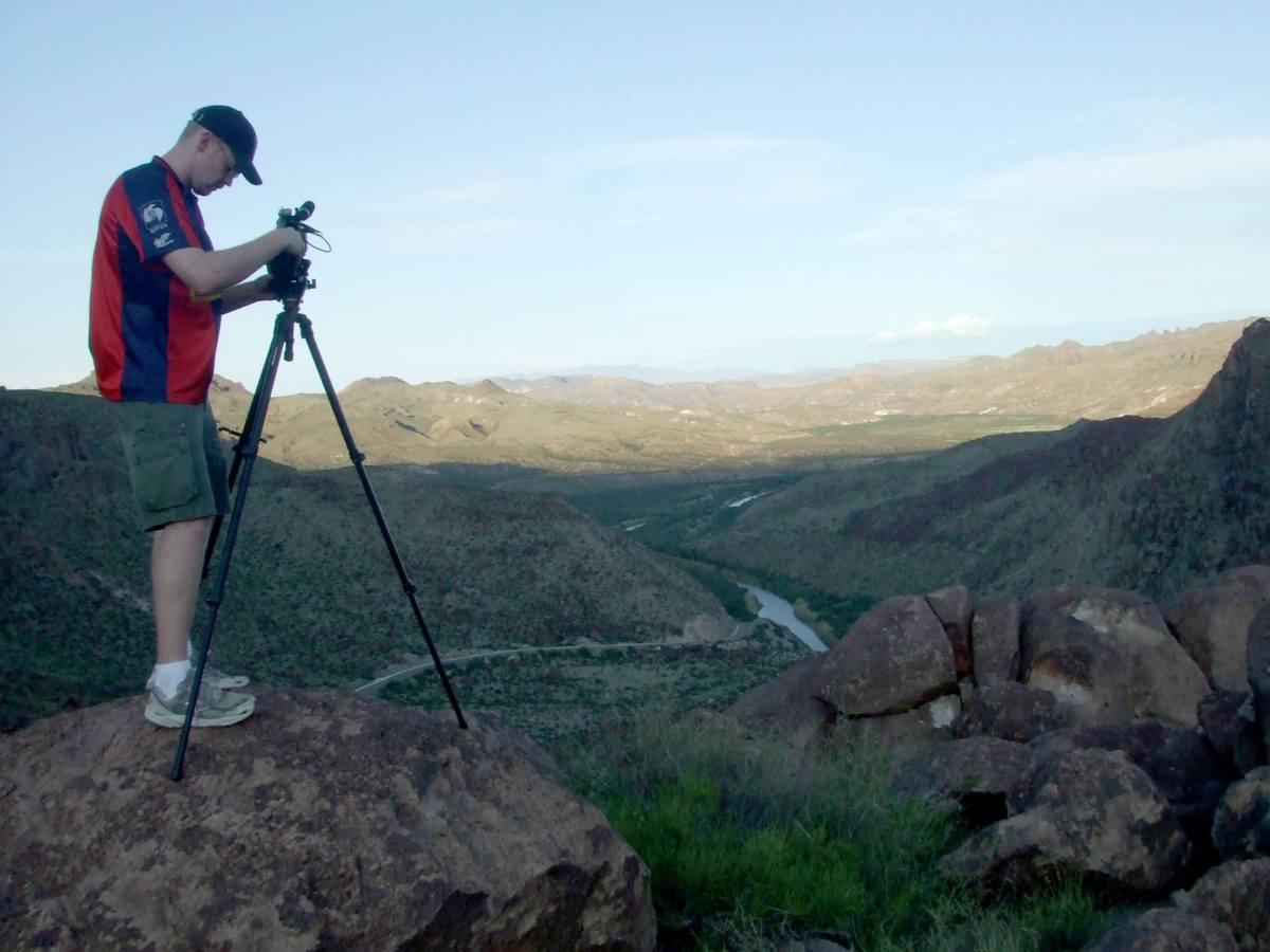 Derrick Perrin with video camera in Big Bend