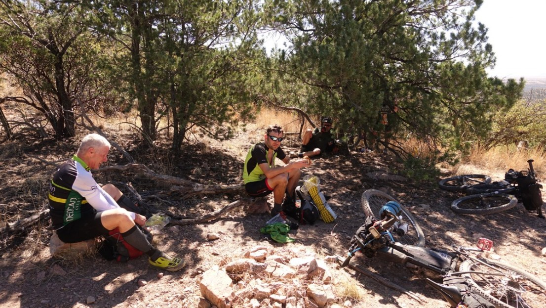 Mountain bike riders hiding in shade