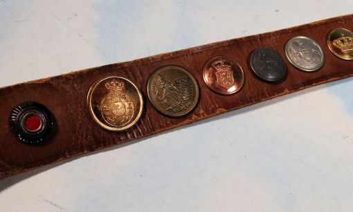 """GERMANY - BELT - """"HATE BELT"""" ASSEMBLED BY AMERICAN SOLDIER - FEATURES TWENTY-FOUR DIFFERENT BUTTONS, INCLUDING A KOKARDE AND OFFICER'S PIPS - Imperial German Military Antiques Sale"""