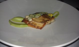 Bass with green almonds, asparagus, nebrodini, and fava