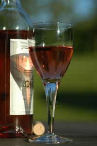 a glass of rose wine playing with the sun 2 1192416 1 - a-glass-of-rose-wine-playing-with-the-sun-2-1192416