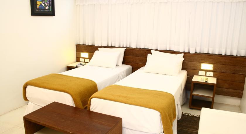Suite Dulo Solteiro do Hotel Delphin Guaruja