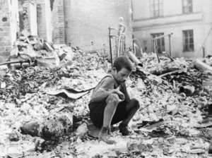 Polish_kid_in_the_ruins_of_Warsaw_September_1939-e1390529720228