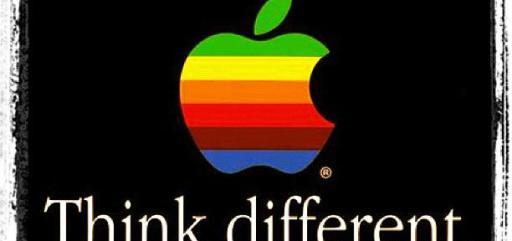 """imagem do antigo logo da Apple, desenho de uma maçã com uma pequena mordida, colorida como arco iris: verde, amarela, laranja, vermelha, roxa e azul. Abaixo, a frase """"Think different."""" em fundo preto."""