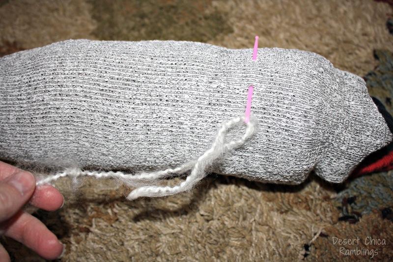 Pull yarn through top of sock head stick horse