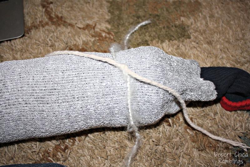 Tie yarn around mop string stick horse