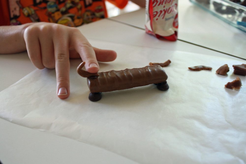 Attach a candy tail to the candy dog craft