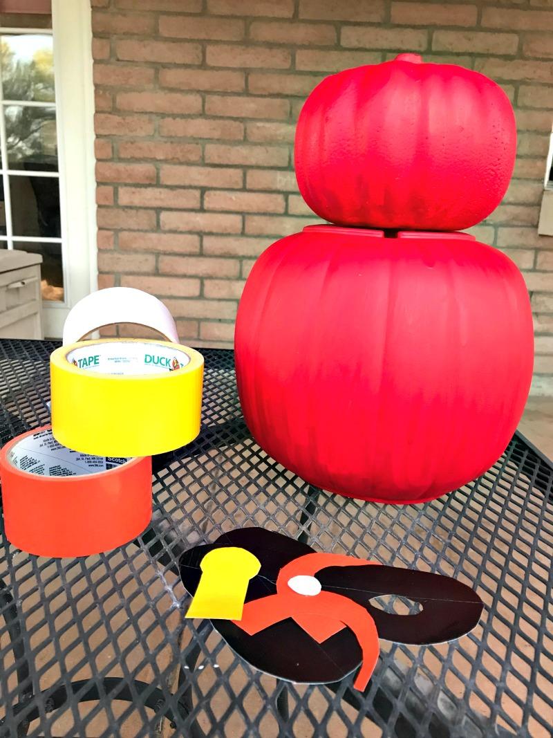 Hot glue the small pumpkin to the big pumpkin to make the Incredibles pumpkin