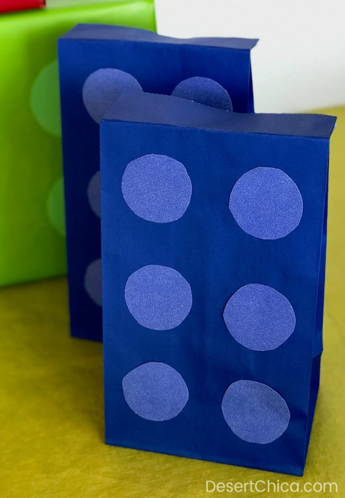 Blue paper bag decorated to look like a LEGO brick