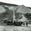 Sightseers on mine railroad 1927. Major Boyd standing near locomotive at Grand View Mine - Courtesy National Park Service, Death Valley National Park