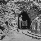 Mr. Ryan in tunnel, Ryan Mine 1914 - County of Inyo, Eastern California Museum