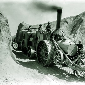 Old Dinah locomotive and ore wagons bringing ore from Borate to Daggett 1900 - Courtesy National Park Service, Death Valley National Park