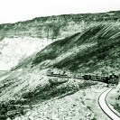 DVRR ore train approaching Ryan (1914 - 1930) - Courtesy National Park Service, Death Valley National Park