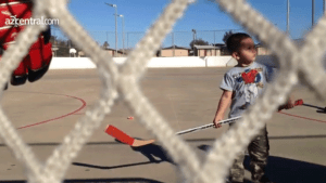 3 year old Adrian Montes and his hockey stick.