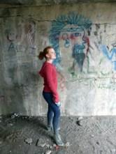 Me, mimicking this comicly drawn graffiti adorning the wall.