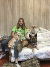 Adama's daughter sitting on couch with dogs